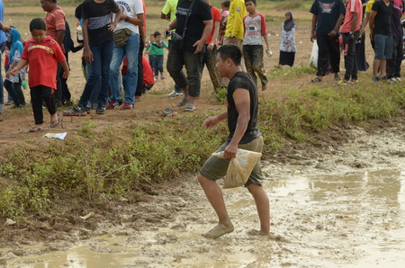 challange: Perlis, Malaysia - March 05, 2017: Perlis East Wind Carnival was a yearly event of Perlis. Consist of food booth, game, challange, contest, and fun park. Capturing Eel Contest