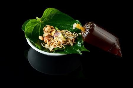 Mieng kham is a traditional snack from Thailand and Laos. The name miang kham translates to one bite wrap, from miang (food wrapped in leaves) and kham (a bite).