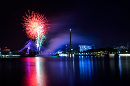 Fireworks show at putrajaya city with putrajaya bridge and obelisk
