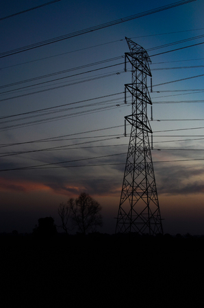 powerline: Powerline at sunset over paddy field