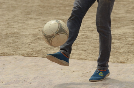 Footballer showing his skills with ball Stock Photo