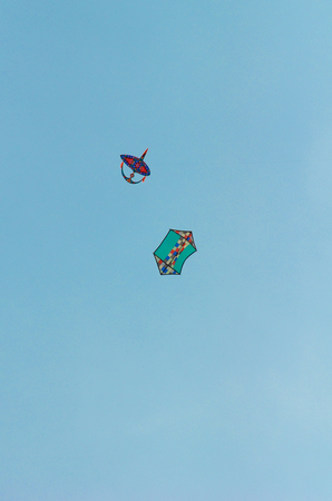 Close view of kite flying in blue sky Stock Photo