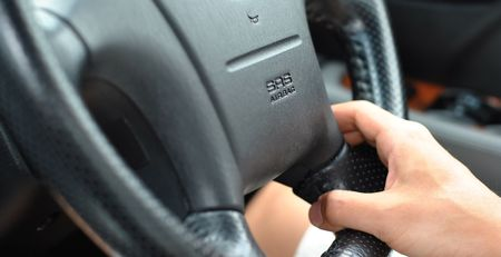 drive safely: car driving with SRS airbag safety feature