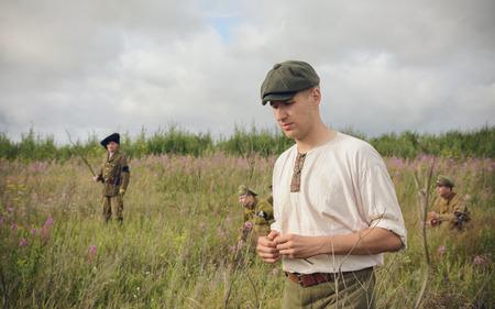POKROVSKOE, SVERDLOVSK OBLAST, RUSSIA - JULY 17, 2016: Historical reenactment of Russian Civil war in the Urals in 1919. Soldier of the militia Editorial
