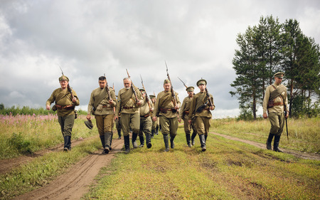 antique rifle: POKROVSKOE, SVERDLOVSK OBLAST, RUSSIA - JULY 17, 2016: Historical reenactment of Russian Civil war in the Urals in 1919. Soldiers Of The White Army
