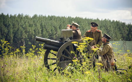 vintage military rifle: POKROVSKOE, SVERDLOVSK OBLAST, RUSSIA - JULY 17, 2016: Historical reenactment of Russian Civil war in the Urals in 1919. Soldier Of The White Army