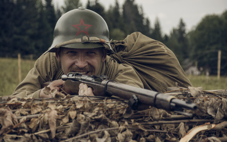 PERM, RUSSIA - JULY 30, 2016: Historical reenactment of World War II, summer, 1942. Soviet soldier with rifle