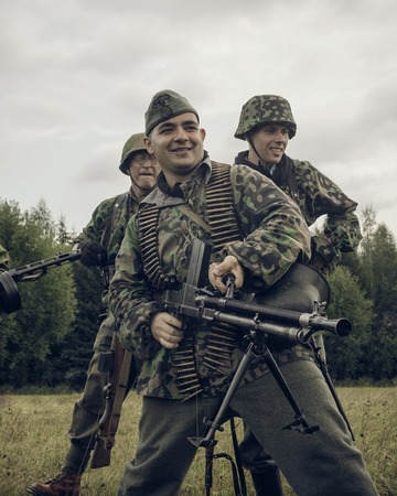 PERM, RUSSIA - JULY 30, 2016: Historical reenactment of World War II, summer, 1942. German soldiers with machne gun Editorial