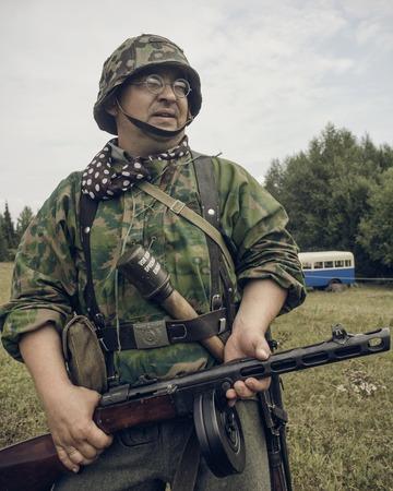 PERM, RUSSIA - JULY 30, 2016: Historical reenactment of World War II, summer, 1942. German soldier with submachine gun Editorial