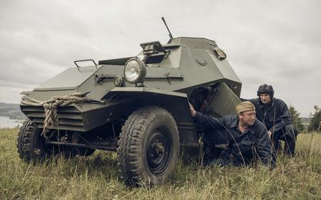 PERM, RUSSIA - JULY 30, 2016: Historical reenactment of World War II, summer, 1942. Crew of soviet armored car Editorial