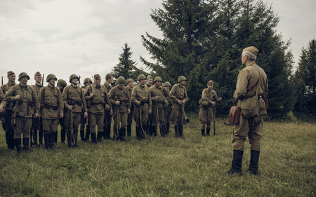 PERM, RUSSIA - JULY 30, 2016: Historical reenactment of World War II, summer, 1942. Soviet officer in front of the line of soldiers Editorial