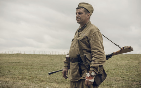 PERM, RUSSIA - JULY 30, 2016: Historical reenactment of World War II, summer, 1942. Soviet soldier with machine gun Editorial