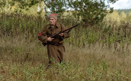 reenacting: KRASNOGVARDEYSKIY, SVERDLOVSK OBLAST, RUSSIA - SEPTEMBER 11, 2016: Historical reenactment of Russian Civil war in the Urals in 1919. Soviet soldier.