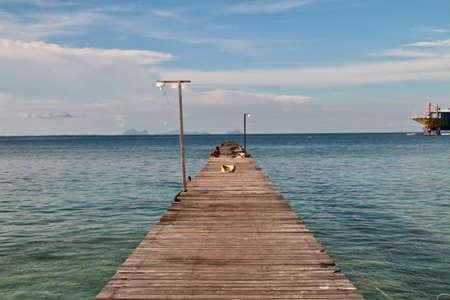 A jetty is a structure that projects from land out into water. It may also refer more specifically to a walkway accessing the centre of an enclosed waterbody.