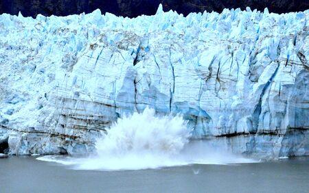 Big glacier caved into the water due to global warming near Glacier Bay, Alaska, U.S.A
