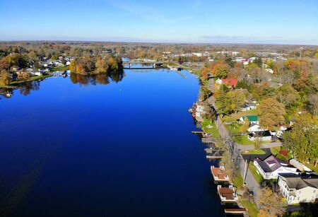 The aerial view of the waterfront homes by Oneida Lake with stunning fall foliage near Syracuse, New York, U.S.A