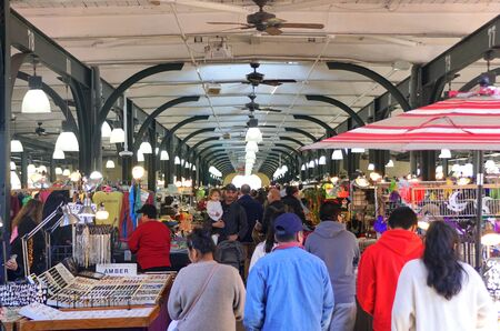 New Orleans, Louisiana, U.S.A - February 7, 2020 -The view of crowds shopping inside of the French Market