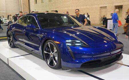 Philadelphia, Pennsylvania, U.S.A - February 9, 2020 - The blue metallic 2020 Porsche Taycan 4S all electric sports sedan Editorial