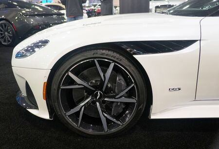 Philadelphia, Pennsylvania, U.S.A - February 9, 2020 - The alloy wheel of the white color 2020 Aston Martin DBS Superleggera sports car