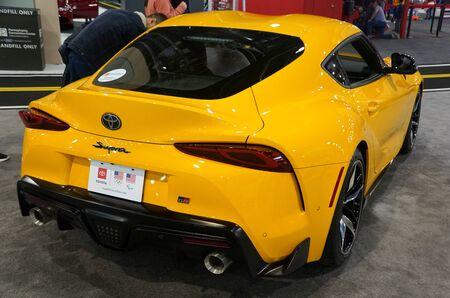 Philadelphia, Pennsylvania, U.S.A - February 9, 2020 - The rear view of the nitro yellow color of 2020 Toyota GR Supra sports car