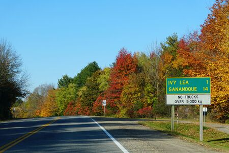 The view of the road towards Ivy Lea and Gananoque with striking fall foliage