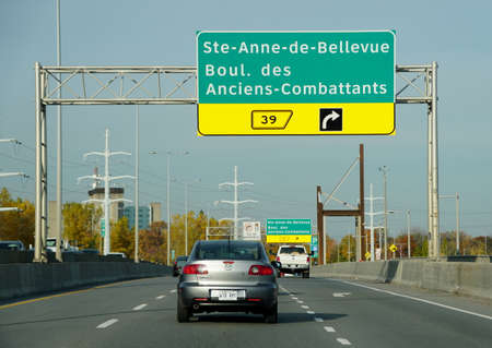 Montreal, Canada - October 28, 2019 - The view of the traffic and exit 39 towards St Anne de Bellevue
