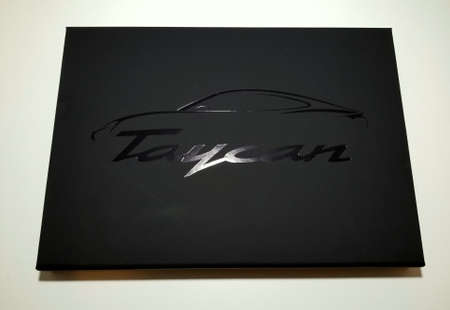 Wilmington, Delaware, U.S.A - June 5, 2019 - The hard cover of a Porsche Taycan all-electric sedan promotional booklet