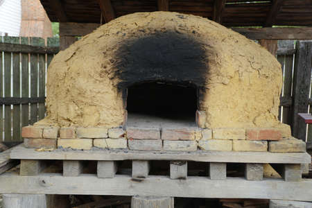 Clay and brick oven with soot and burned marks Imagens