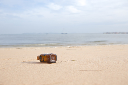 Place the bottle on the beach photo