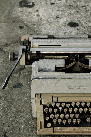 Ancient typewriter used in unsanitary conditions. photo