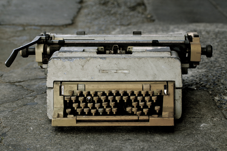 unsanitary: Ancient typewriter used in unsanitary conditions. Stock Photo