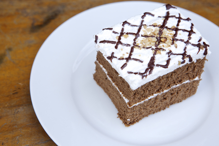 carrot cake: Carrot cake on a white plate.