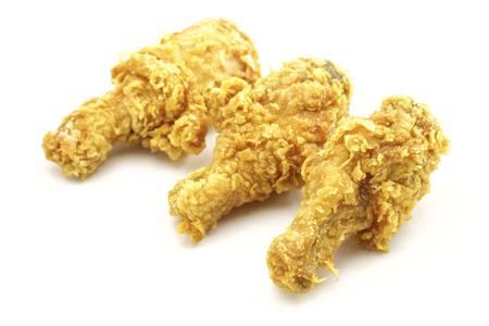 binge: A crispy golden fried chicken leg. Isolated on white.