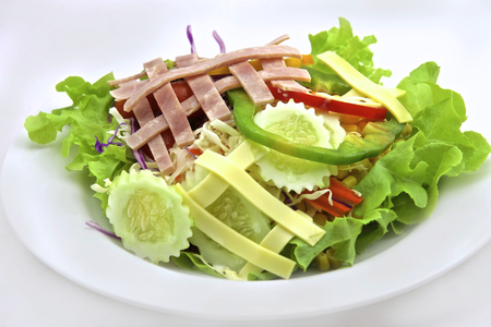 Green salad with tomatoes, onions, and ham
