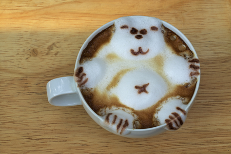 couching: coffee shop latte with decorative bear
