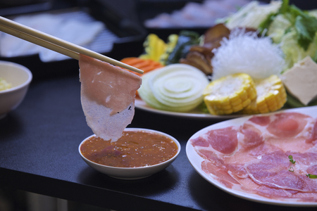 turn over: Components used in making shabu and turn over the meat. Stock Photo