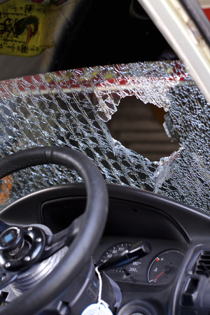 demolishing: broken window of a car after accident. cracked windshield background Stock Photo