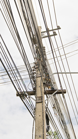 power pole: High voltage power pole with wires tangled Stock Photo