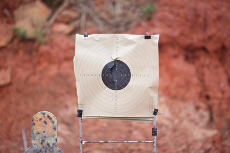 gun holes: Target gun made of paper in the shooting.