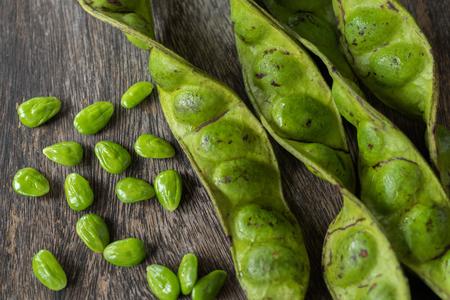 Bitter bean on wooden background.