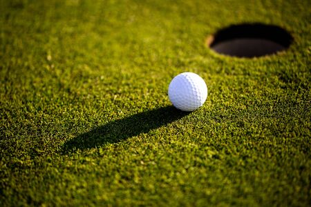 Closeup of golf ball on the grass, ready for playing professional golf