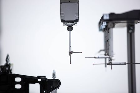 Close up of professional automatic 3D measuring system machine for plastic moldings, industrial and automotive concept