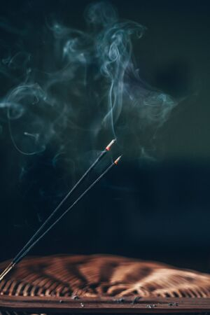Burning incense stick during meditation ritual, respiratory therapy