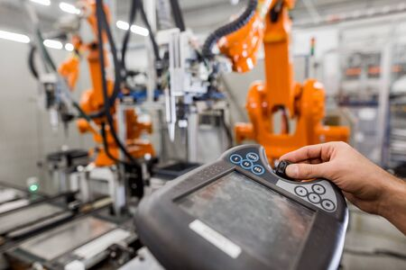 Technician man programming robot in automotive industrial, professional programmer, industry concept 스톡 콘텐츠