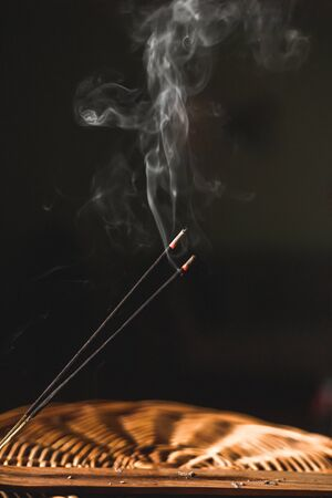 Burning, smoking incense stick during meditation ritual, spirituality concept Banco de Imagens