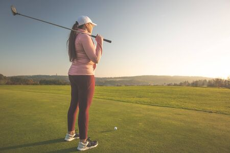 Professional woman golf player on the golf ground ready for playing golf
