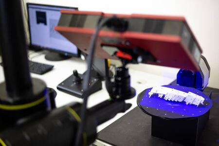 Professional 3D scanner scanning an industrial object, plastic molding placed on a turntable, metrology concept Stock Photo