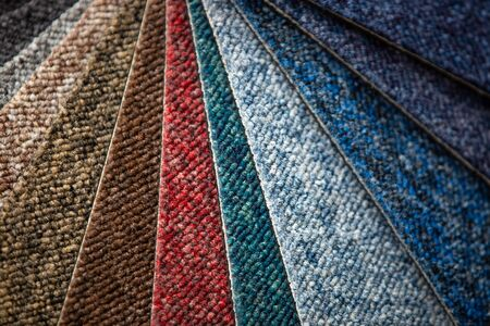 Close up huge arrenge of colorful carpets, floor sampler, swatch 写真素材