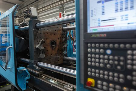 Huge injection molding machine without fixture, ready for the plastic articles by injecting heated material into mold, automotive industry