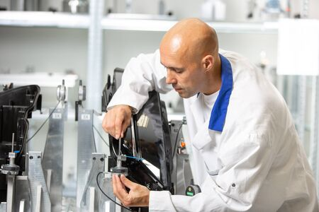 Quality engineer measuring plastic components by digital meter on the fixture, automotive and metrology concept Stockfoto